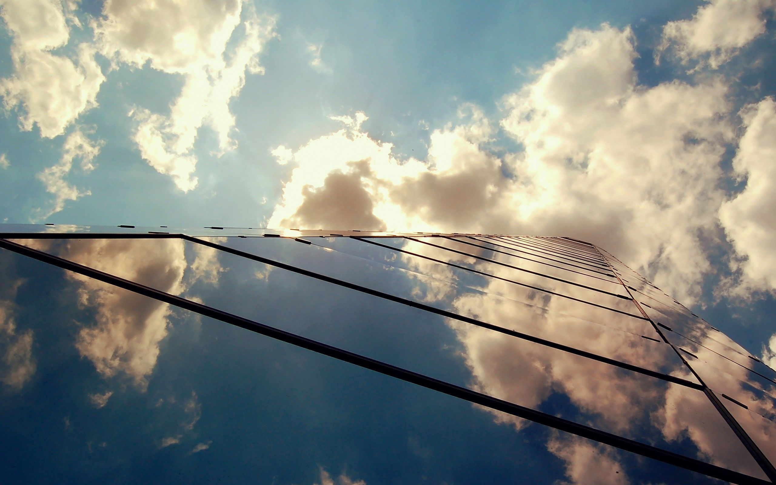 clouds-reflecting-in-glass-building-world-hd-wallpaper-2560x1600-9152